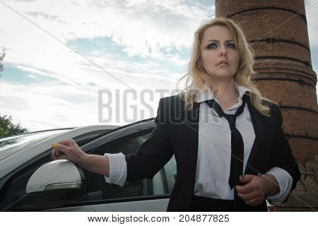 Noir Film Style Woman In A Black Suit