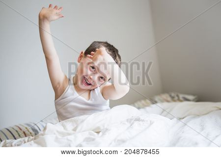 A Young Boy Sleeping In Bed at home