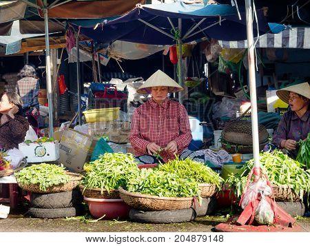 Hue, Vietnam - September 13 2017: Unidentified woman in the streets selling food, located in Hue in Vietnam.