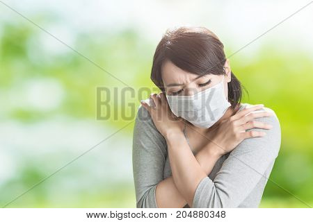 woman get sick and feel cold on the green background