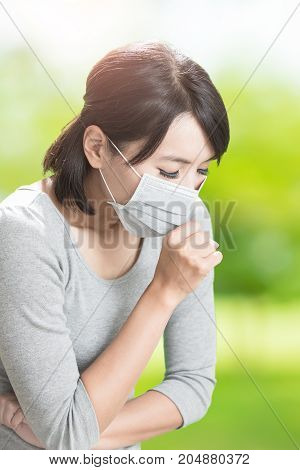 woman get sick and cough on the green background