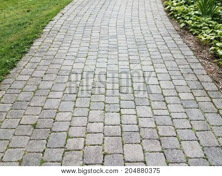 a stone path or walkway made out of grey stone squares