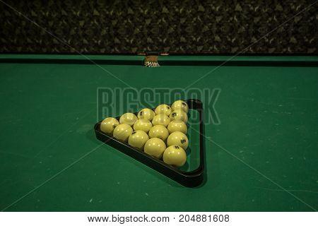 Billiards balls an cue on billiards table
