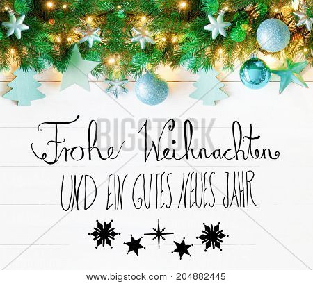 Garland With Turquoise Christmas Ball Ornament. Fir Brances With Fairy Lights. White Background With German Calligraphy Frohe Weihnachten Und Gutes Neues Jahr Means Merry Christmas And Happy New Year