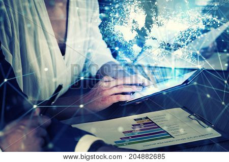 Businessperson in a modern office connected on internet network with tablet. concept of partnership and teamwork
