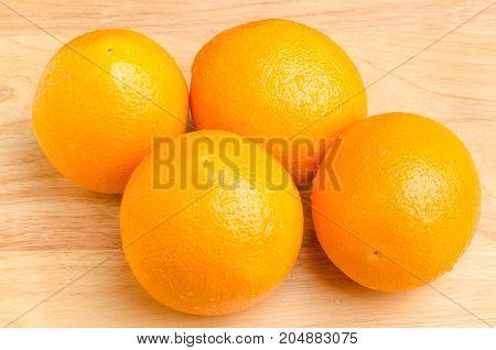 Navel orange fruit on wooden background,healthy fruit