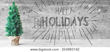 Calligraphy With English Text Happy Holidays. Green Christmas Tree With Gray Wooden Background And Snowflakes.