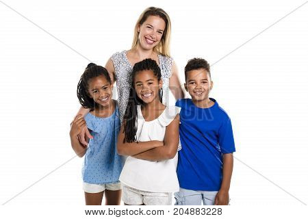 Two Afro twin child and boy posing on a white background studio with white mother
