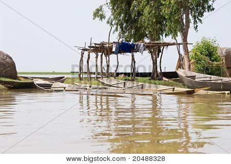 A boatbuilder's workshop on Niger river, Africa