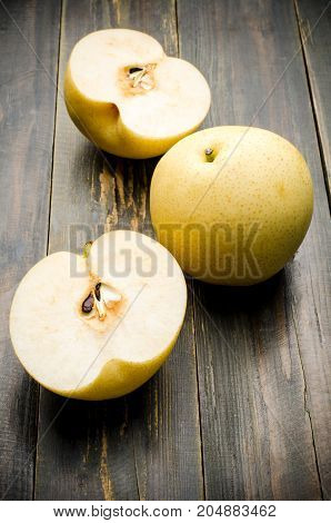 Ripe Asian pears fruit on wooden background