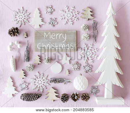Sign With English Text Merry Christmas. Flat Lay Of Christmas Decoration Like Tree, Ball, Star And Fir Cone. Rose Quarty Wooden Background