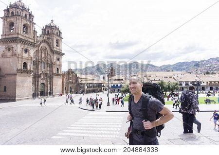 The plaza armas in cusco with traveler on the front