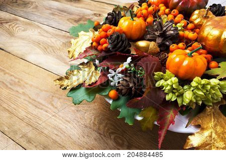 Fall Or Thanksgiving Holiday Arrangement With Pumpkins And Autumn Leaves