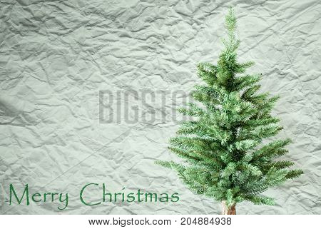 Crumpled Paper Background WIth English Text Merry Christmas. Christmas Tree Or Fir Tree In Front Of Textured Background.