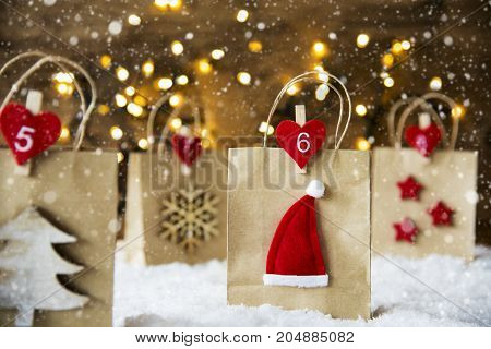 Christmas Shopping Bag With Numbers 5 to 8 On Snow. Decoration Like Santa Claus Hat, Snowflake, Christmas Tree And Stars. Fairy Lights In Background. Snowing Scenery With Snowflakes