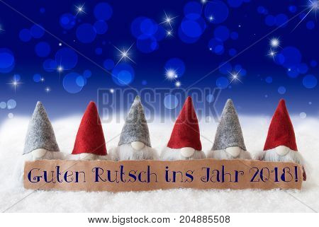 Label With German Text Guten Rutsch Ins Jahr 2018 Means Happy New Year 2018. Christmas Greeting Card With Gnomes. Sparkling Bokeh And Blue Background With Snow And Stars.