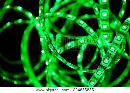 Close up of Green Led stripe light on black background Selective focus
