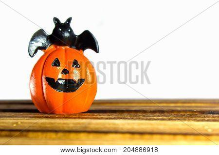 Halloween pumpkin smile on wood plate : white background.