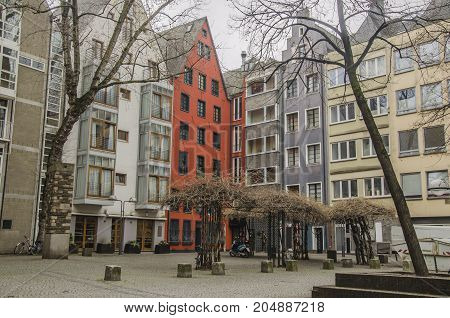 city of cologne a space of peace in the center of the city multicolored buildings surround an inner square