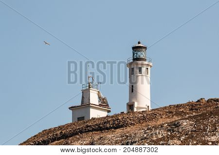 Anacapa lighthouse and adjacent building on Anacapa Island, a volcanic island off the coast of Southern California, and part of the Channel Islands National Park.
