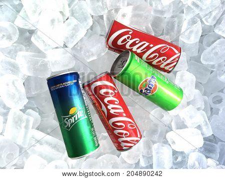 BANGKOK THAILAND - AUGUST 31 2017: Soda pop soft drink slim cans on ice background.