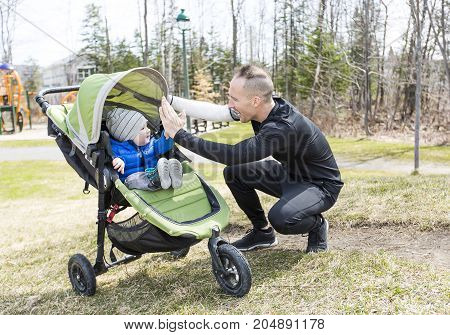 A Father and son walking in the park. Family and sport concept.