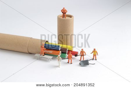 The Team Of Workers Work On Color Pen