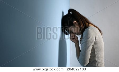 The depression woman feel sad and hammer the wall
