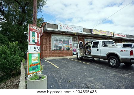 JOLIET, ILLINOIS / UNITED STATES - JULY 24, 2017:  One may purchase airplane and bus tickets at Aries Travel, in a strip mall on Plainfield Road.