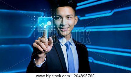 businessman touch bigdata icon on blue background