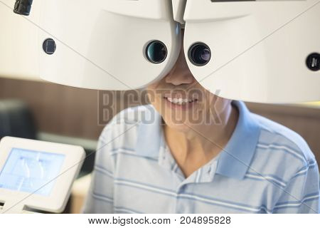 old man with optometry in the optical shop