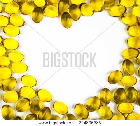 Heart shaped of cod liver oil isolated on white background with copy space. Source of Omega-3 (DHA+EPA) and vitamin A & D helps growth development and absorption of calcium and phosphorous in the body