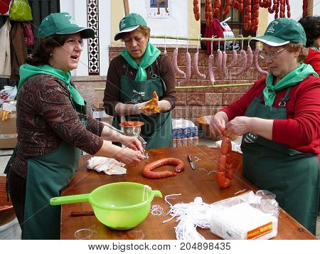 Ardales Spain - February 24 2007: People making sausages at village Pig Slaughter festival