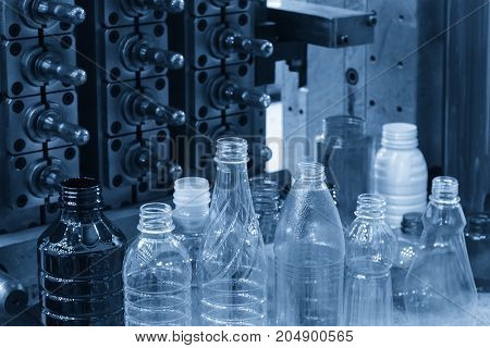 The sample of plastic bottle product and pre-shape part .Plastic bottle container product.