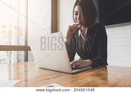 Smart Asian Woman Holding Credit Card And Using Laptop Computer. Online Shopping Concept