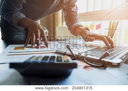 Accountants Work Analyzing Financial Reports On A Laptop At His Office, Business Concept