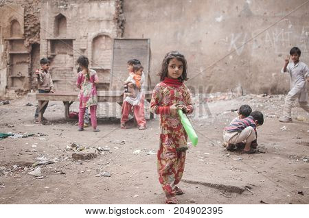 Old Delhi India : February 15th 2015 - Shot of children playing at a ruin in Old Delhi India