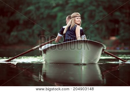 tender couple boating on clean lake, people have holiday on calm river, romantic couple have quite rest on nature