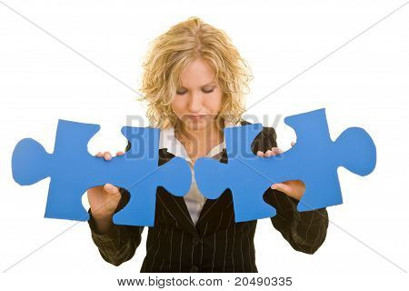 Business Woman Combining Two Jigsaw Pieces