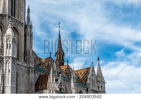 Budapest, Hungary - August 12, 2017: Dteail of roof of Matthias Church. It is a Roman Catholic church located in front of the Fisherman's Bastion at the heart of Buda's Castle District.