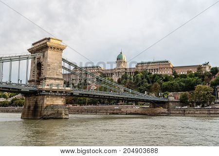 Budapest, Hungary - August 12, 2017:   Chain Bridge. It is a suspension bridge that spans the River Danube between Buda and Pest, was the first permanent bridge across the Danube in Hungary.