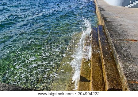 Steps at the Adriatic sea in summer