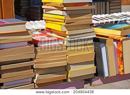 Old books for sale outdoor in summer