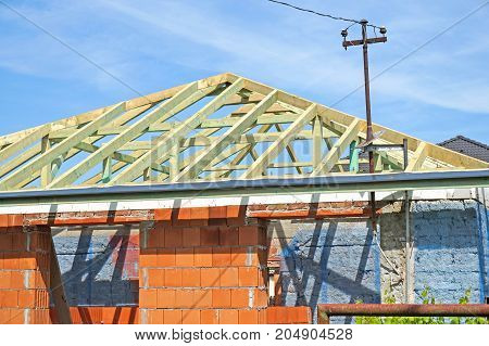 New house under construction in summer time