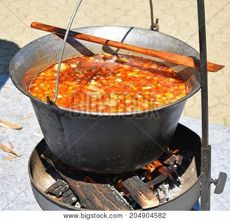Cooking goulash outdoor in summer time out