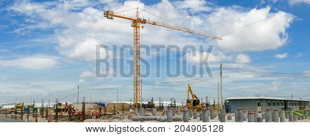 tower crane Construction site with cranes and building with blue sky background