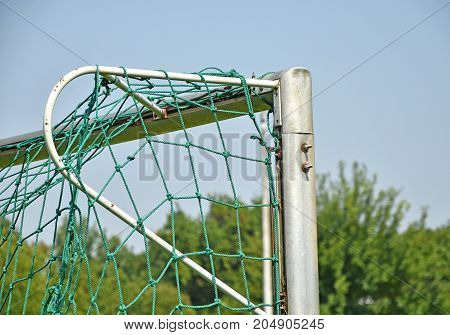 Soccer goal with net in summer time