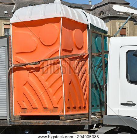 Portable toilets on a vehicle in summer