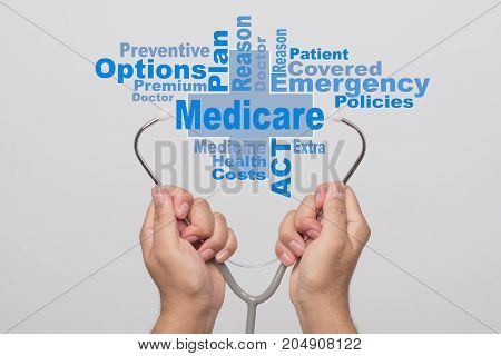 Health Care Concept. Doctor hands holding a stethoscope and word