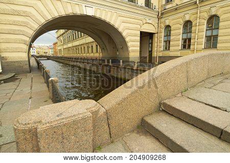 urban architecture.Granite bridge over the canal in the city.